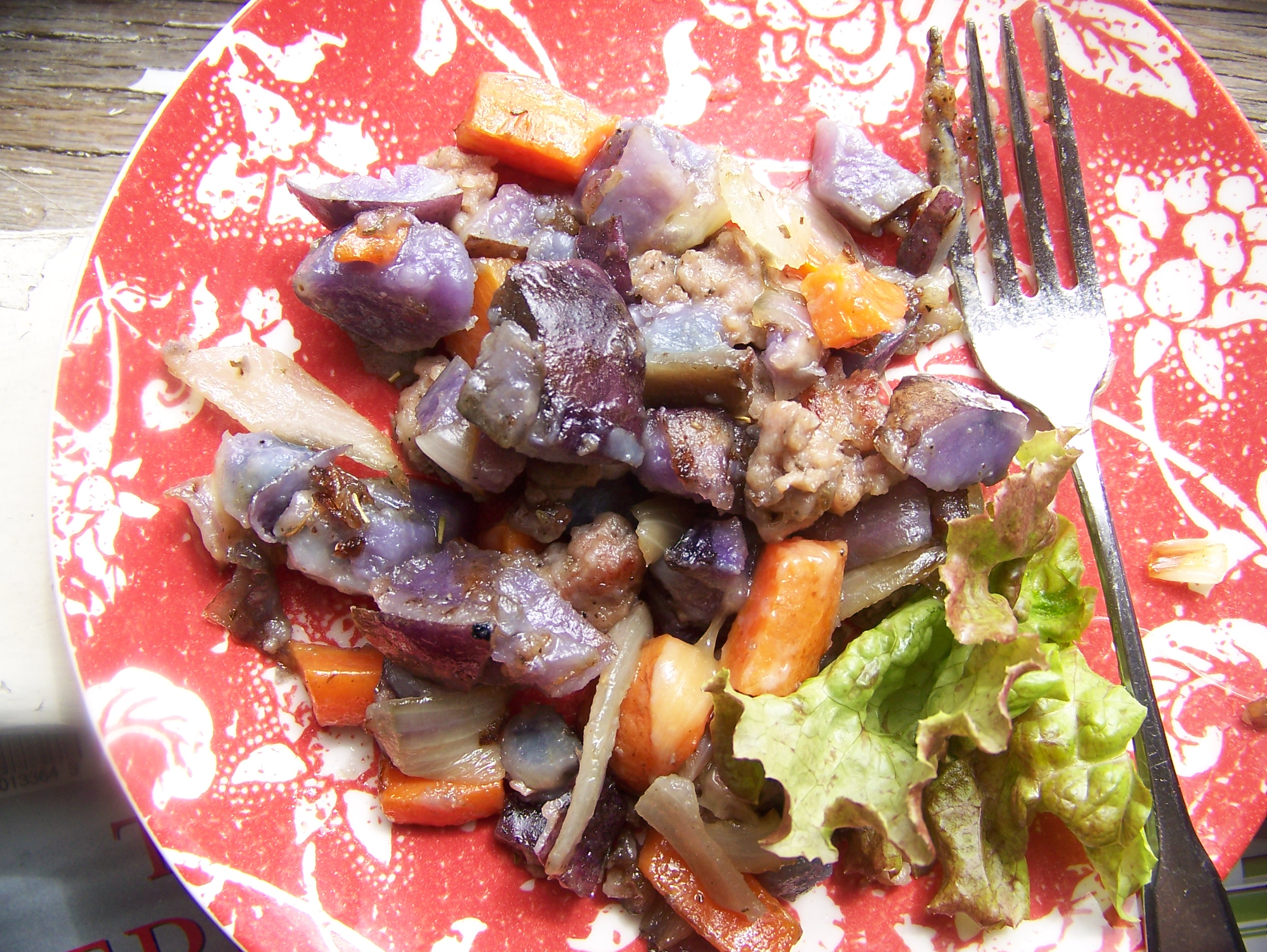 Sausage, carrots, onions, taters. garnished with a bit of lettuce.